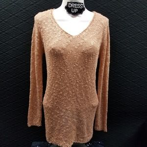 Knitted beige long sleeve top.